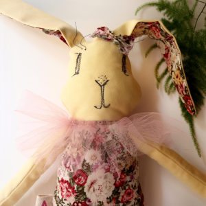 hare-stuffed-animal-sewing-black-thread-big-ears